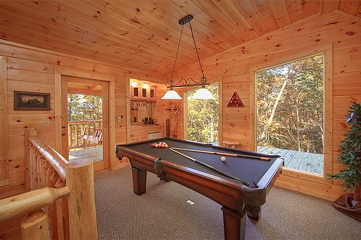 Lofted game room with pool table at Tucked Away, a 2 bedroom cabin rental located in Gatlinburg