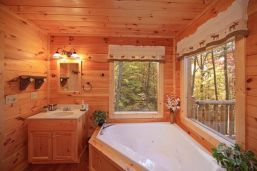 Main level en suite bath with jacuzzi at Tucked Away, a 2 bedroom cabin rental located in Gatlinburg