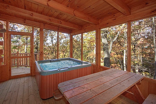 screened deck with hot tub at tucked away a 2 bedroom cabin rental located in gatlinburg