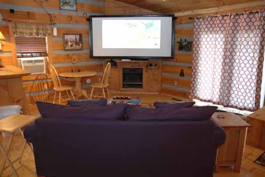 enjoy movies and television on a 10 foot projector screen at a panoramic view a 1 bedroom cabin rental located in pigeon forge