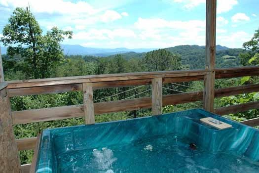enjoy the views from the hot tub on a covered deck at a panoramic view a 1 bedroom cabin rental located in pigeon forge
