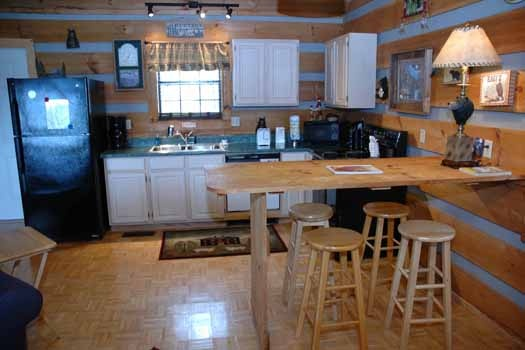 kitchen with barstools at a panoramic view a 1 bedroom cabin rental located in pigeon forge