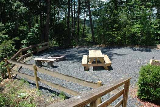enjoy the outdoors at the firepit or picnic table at a panoramic view a 1 bedroom cabin rental located in pigeon forge