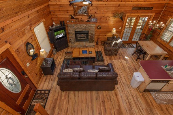 Looking down on to the main floor at Owl Be Back, a 2 bedroom cabin rental located in Gatlinburg