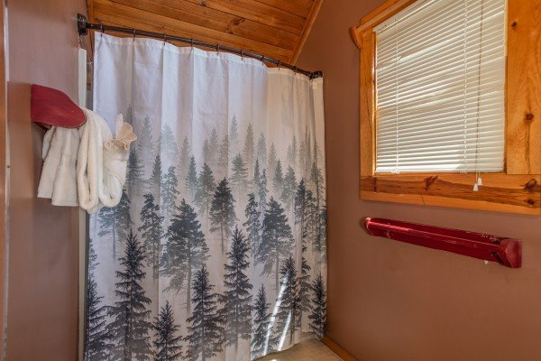 Bathroom with a tub and shower at Owl Be Back, a 2 bedroom cabin rental located in Gatlinburg
