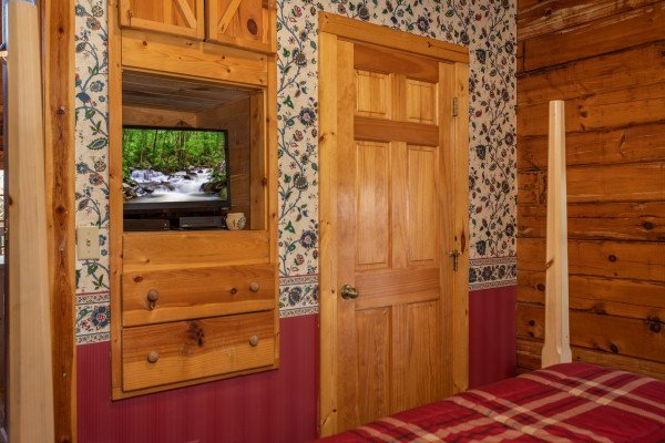 Built in dresser and flat screen TV at Owl Be Back, a 2 bedroom cabin rental located in Gatlinburg