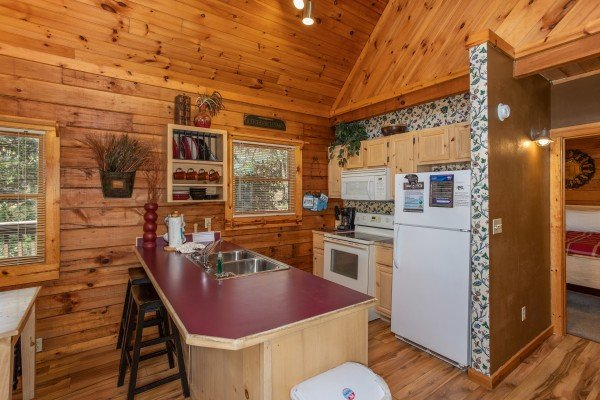Kitchen with white appliances at Owl Be Back, a 2 bedroom cabin rental located in Gatlinburg