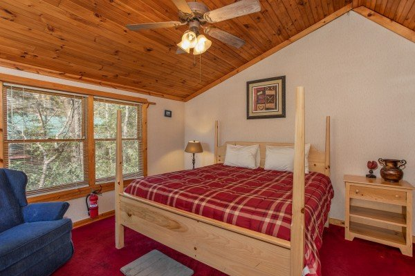 King four-post bed in the loft at Owl Be Back, a 2 bedroom cabin rental located in Gatlinburg