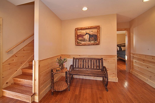 bench seating at the first floor stair landing at horse'n around a 3 bedroom cabin rental located in pigeon forge