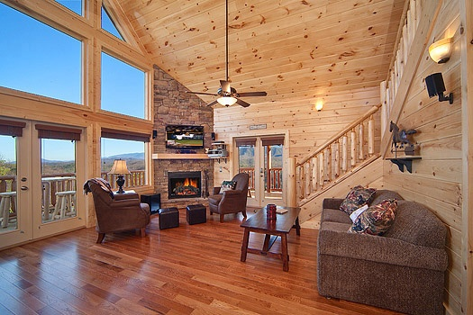 living room with stone fireplace at horse'n around a 3 bedroom cabin rental located in pigeon forge