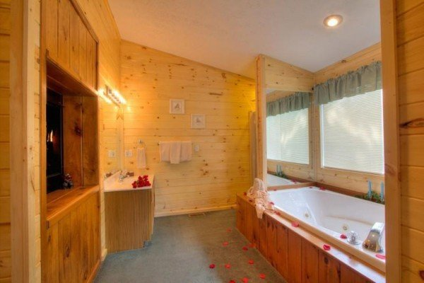 Jacuzzi tub with fireplace at A Dream Romance, a 1 bedroom cabin rental located in Gatlinburg