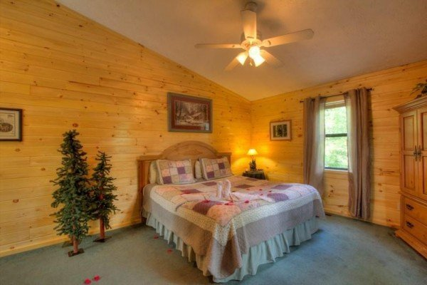 Bedroom with armoire at A Dream Romance, a 1 bedroom cabin rental located in Gatlinburg