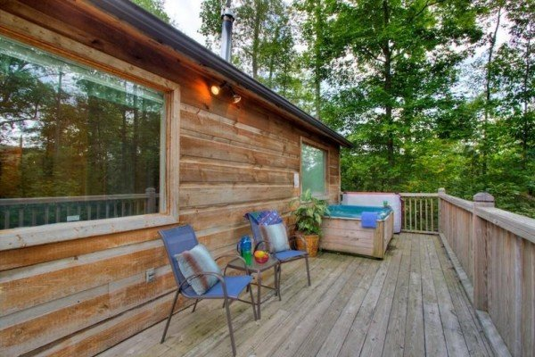 Outdoor seating and hot tub on a deck at A Dream Romance, a 1 bedroom cabin rental located in Gatlinburg