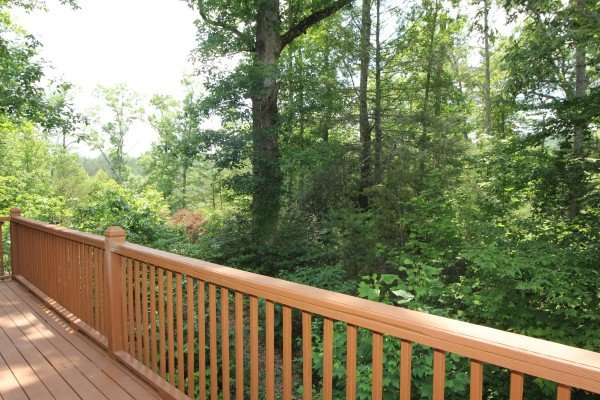 A wooded deck view at A Dream Romance, a 1 bedroom cabin rental located in Gatlinburg