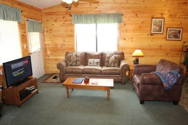 Living room with couch and television at A Dream Romance, a 1 bedroom cabin rental located in Gatlinburg