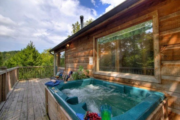Outdoor hot tub on a deck at A Dream Romance, a 1 bedroom cabin rental located in Gatlinburg