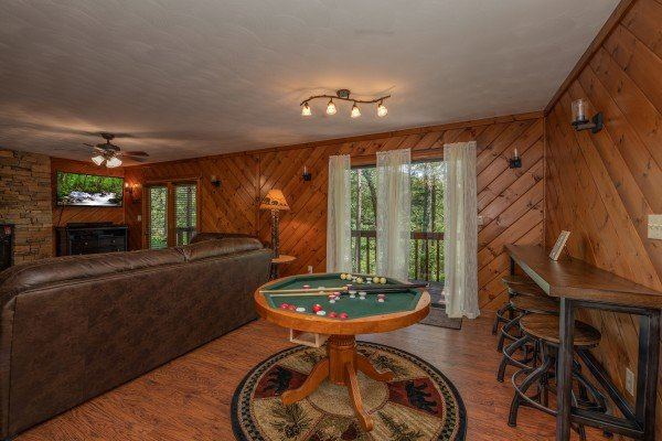 Dining table converted to a bumper pool table at Bear Necessities, a 3 bedroom cabin rental located in Pigeon Forge