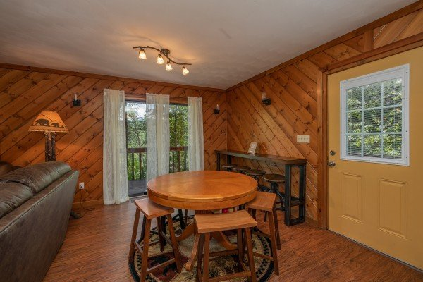 Dining table for 4 with a sideboard for 4 at Bear Necessities, a 3 bedroom cabin rental located in Pigeon Forge