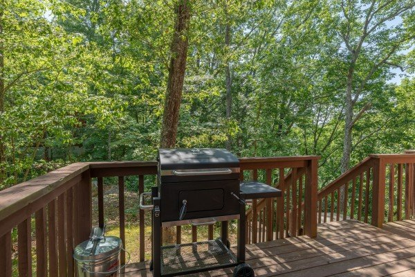 Grill on the open deck at Bear Necessities, a 3 bedroom cabin rental located in Pigeon Forge