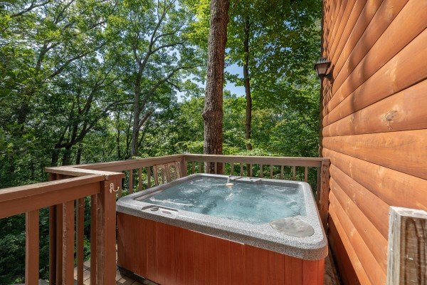 Hot tub on the open deck at Bear Necessities, a 3 bedroom cabin rental located in Pigeon Forge