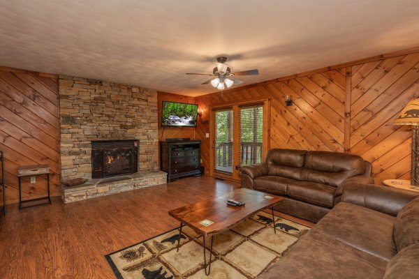 Living room with fireplace, TV, and two sofas at Bear Necessities, a 3 bedroom cabin rental located in Pigeon Forge