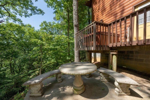 Dining table on a patio at Bear Necessities, a 3 bedroom cabin rental located in Pigeon Forge