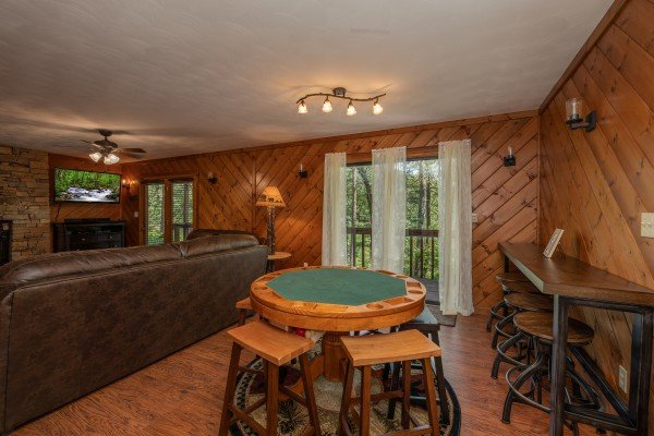 Dining table converted to a poker table at Bear Necessities, a 3 bedroom cabin rental located in Pigeon Forge