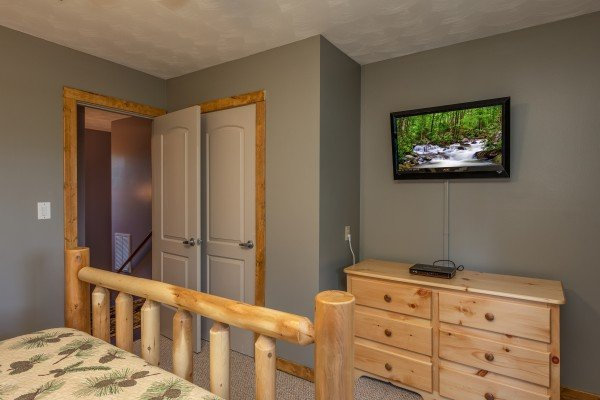 Dresser and TV in the bedroom at Bear Necessities, a 3 bedroom cabin rental located in Pigeon Forge