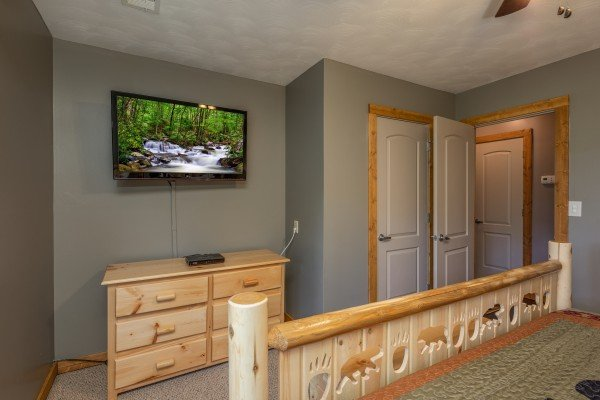 Dresser and TV in a bedroom at Bear Necessities, a 3 bedroom cabin rental located in Pigeon Forge