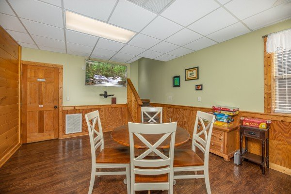 Four person table at Southern Charm, a 2 bedroom cabin rental located in Pigeon Forge