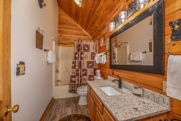 Bathroom with a tub and shower at Southern Charm, a 2 bedroom cabin rental located in Pigeon Forge