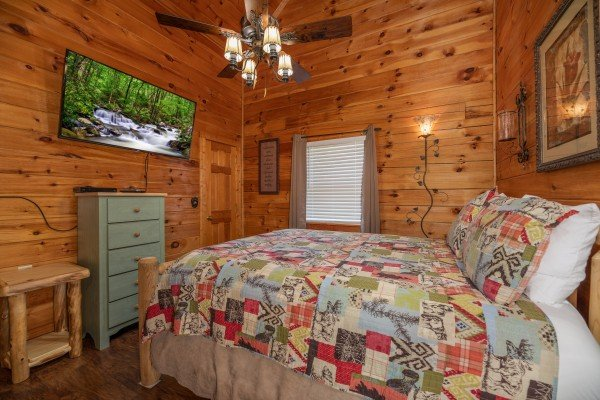 Dresser, TV, and end table in a bedroom at Southern Charm, a 2 bedroom cabin rental located in Pigeon Forge