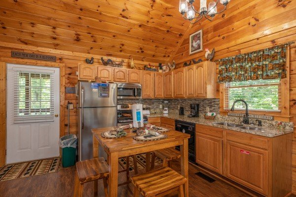 Kitchen with dining set for four at Southern Charm, a 2 bedroom cabin rental located in Pigeon Forge