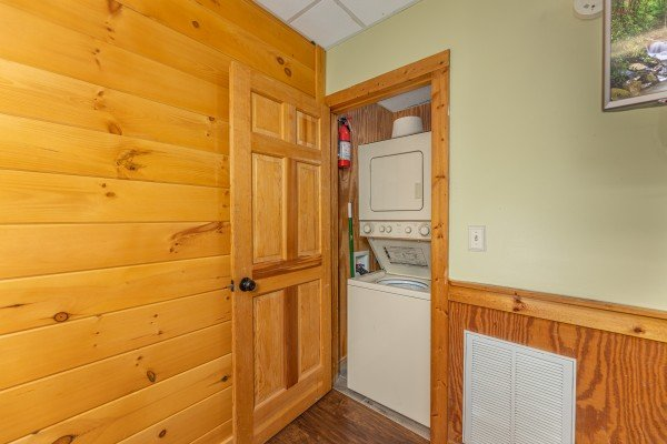 Stacked washer and dryer at Southern Charm, a 2 bedroom cabin rental located in Pigeon Forge