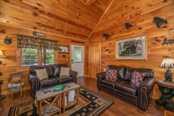 Two loveseats in the living room at Southern Charm, a 2 bedroom cabin rental located in Pigeon Forge