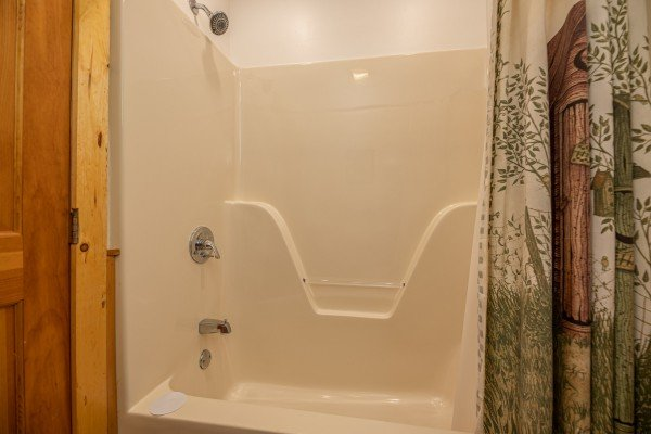 Tub and shower in a bathroom at Southern Charm, a 2 bedroom cabin rental located in Pigeon Forge