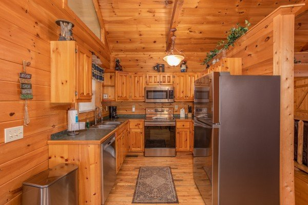 Kitchen with stainless steel appliances at Bearly in the Mountains, a 5-bedroom cabin rental located in Pigeon Forge