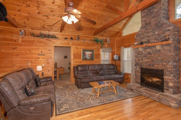 Living room with two couches and a stone fireplace at Bearly in the Mountains, a 5-bedroom cabin rental located in Pigeon Forge