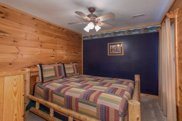 Queen-sized bed in a bedroom at Bearly in the Mountains, a 5-bedroom cabin rental located in Pigeon Forge