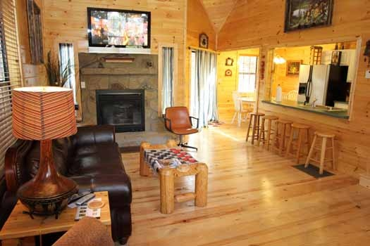 living room with fireplace at sweet dreams lodge a 3 bedroom cabin rental located in pigeon forge