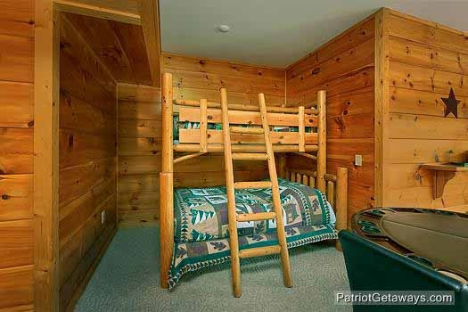 Twin over full bunk in the game room at Flying with Eagles, a 3-bedroom cabin rental located in Pigeon Forge