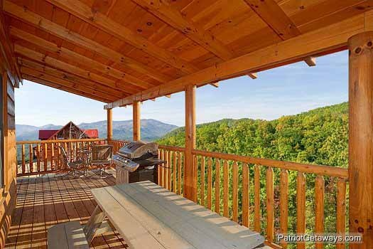 Covered deck with picnic table and grill at Flying with Eagles, a 3-bedroom cabin rental located in Pigeon Forge