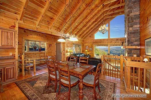 Dining table with seats for six with views of Mount LeConte at Flying with Eagles, a 3-bedroom cabin rental located in Pigeon Forge