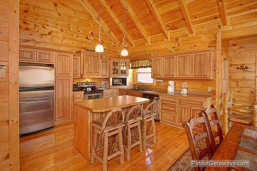 Kitchen island with bar stools at Flying with Eagles, a 3-bedroom cabin rental located in Pigeon Forge