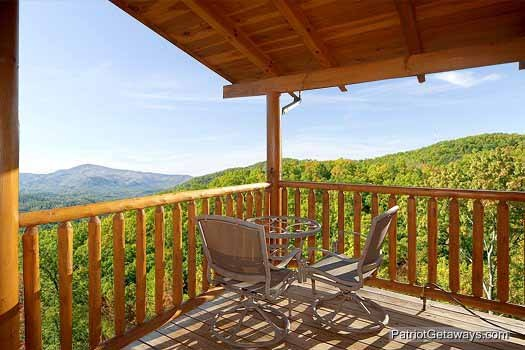 Patio table and chairs on the deck at Flying with Eagles, a 3-bedroom cabin rental located in Pigeon Forge