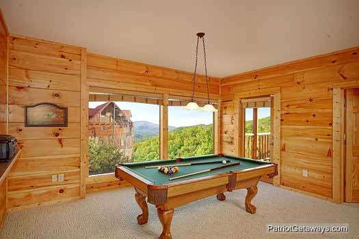 Pool table in the game room at Flying with Eagles, a 3-bedroom cabin rental located in Pigeon Forge