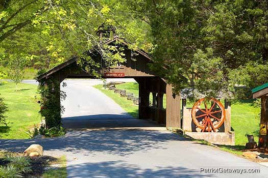Resort entrance covered bridge at Flying with Eagles, a 3-bedroom cabin rental located in Pigeon Forge