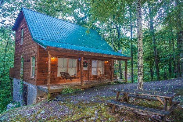 Exterior view of front porch at Denim Blues, a 1-bedroom cabin rental located in Gatlinburg