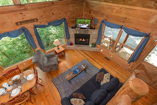 Living room as viewed from upstairs at Denim Blues, a 1-bedroom cabin rental located in Gatlinburg