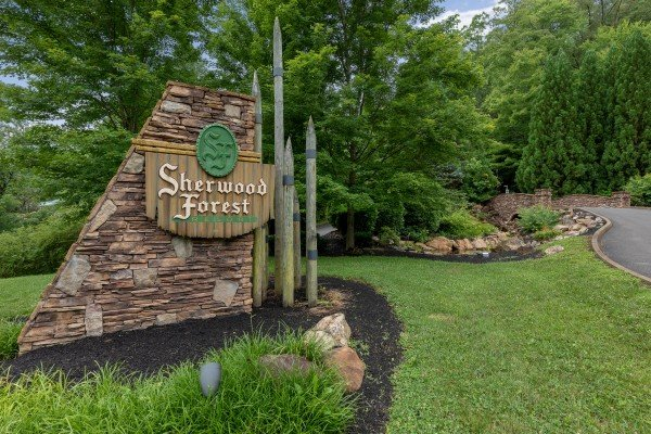 Sherwood Forest sign at The Pool Palace, a 5 bedroom cabin rental located in Pigeon Forge